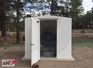 8 x 6 fiberglass shelter over a fiberglass Packaged Metering Manhole