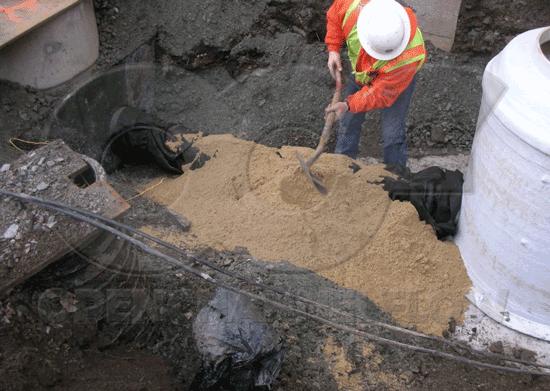 backfilling fiberglass Metering Manhole excavation under piping