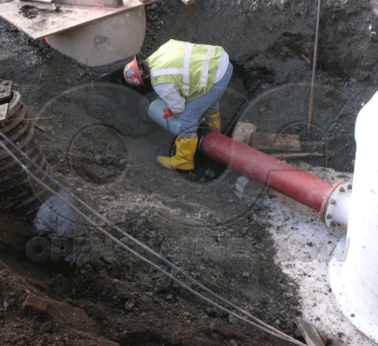 connecting fiberglass Metering Manhole to piping