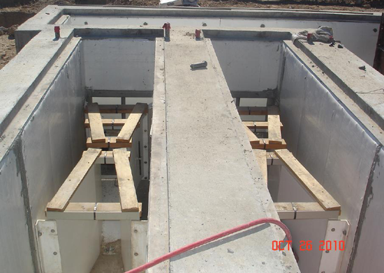 Two small sized FRP Parshall flumes being installed in concrete channels