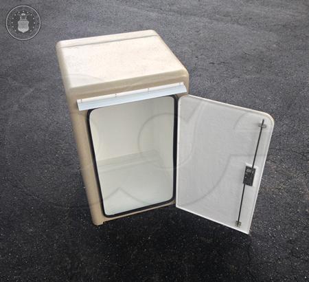Fiberglass sampler enclosure with front door open - two point stainless steel hardware, integral door seal, and drip cap visible