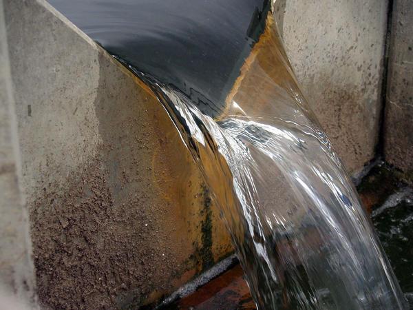 flow over a v-notch weir plate