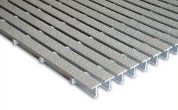 narrow opening fiberglass grating used in spill containment floors of fiberglass chemical storage shelters
