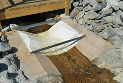 Openchannelflow Fiberglass Trapezoidal Flume measuring runoff at a utility