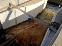 Fiberglass Parshall flume installed in a concrete channel
