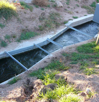 flow in a submerged galvanized steel parshall flume measuring water rights flows