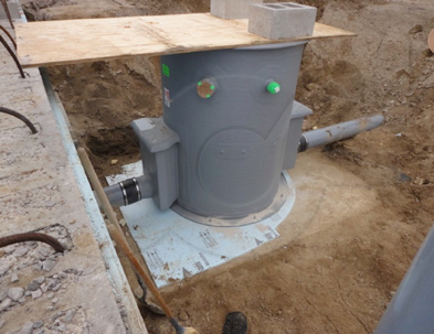a properly sized concrete slab for a fiberglass packaged flow metering manhole