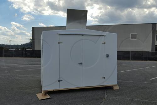 double door fiberglass buidling with an open roof hatch