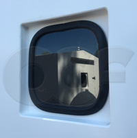 observation window on a fiberglass equipment shelter manufactured by Openchannelflow
