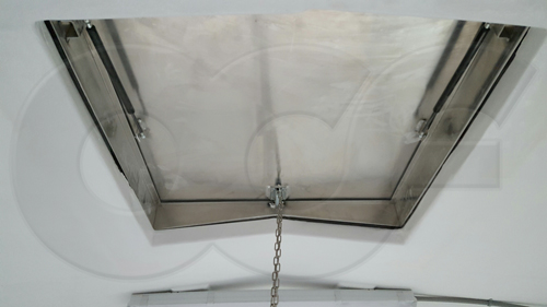 an interior view of an aluminum hatch mounted in the roof of a fiberglass equipment building - shelter