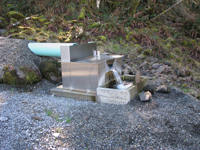 pipe flow spilling into an Openchannelflow stainless steel weir box measuring dam seepage