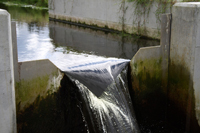 flow of clean water over a v-notch weir in a concrete channel